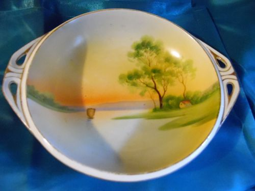 Nippon sailboat on lake at sunset serving bowl