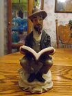 Homco style Seated man with pipe reading book figurine