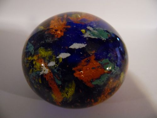 Multi color coral reef glass paperweight.