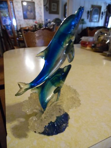 Double Dolphin figurine breaching the water