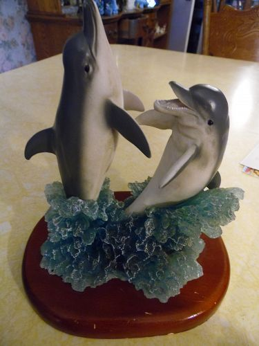 Dolphin duo breaching the waves figurine