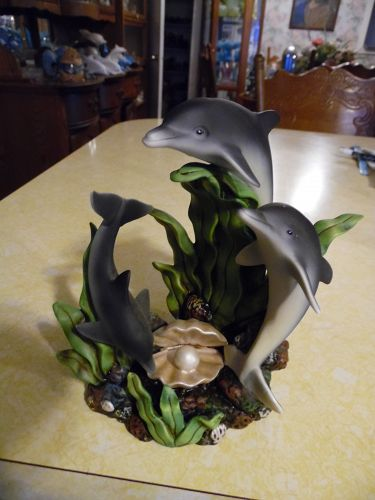 Fine porcelain dolphin trio in the sea figurine