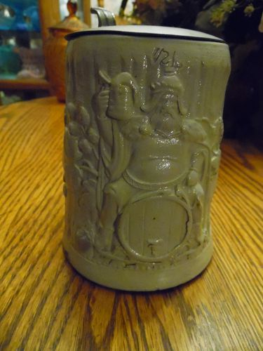 Antique German pottery stein with Viking sitting on a keg pewter lid