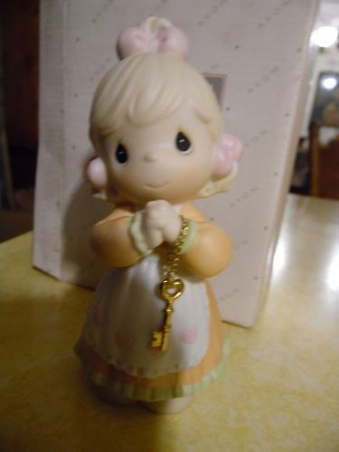 Avon Precious Moments Love is the key figurine