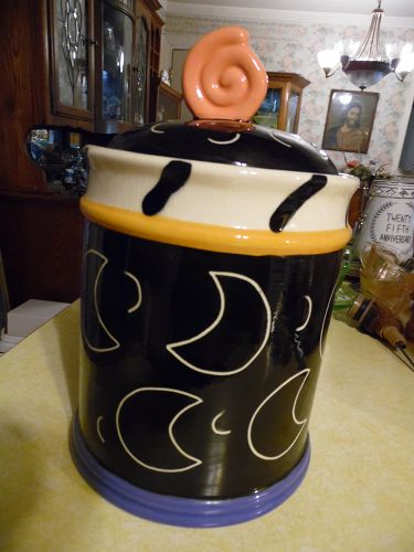 Large black cookie jar with crescent moons and candy finial  LA CA