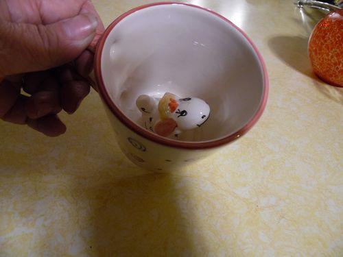 Vintage ceramic mug with surprise animal inside