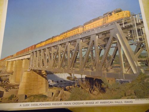 Union Pacific Diesel power freight crosses bridge color print late 50s