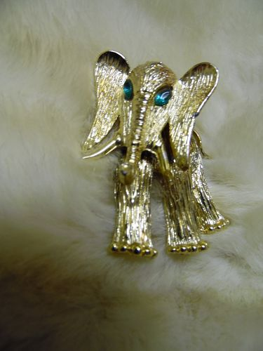Vintage goldtone brushed trembler elephant pin rhinestone eyes
