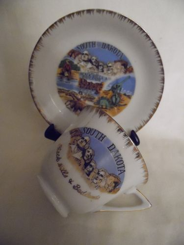 Vintage souvenir cup and saucer South Dakota Black Hills and Badlands