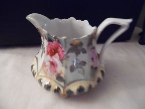 RS Prussia hand painted creamer ornate with 8 feet circa 1800's