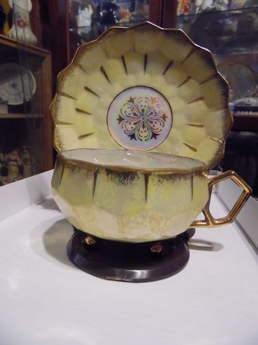 Fancy vintage lustre three legs toes feet yellow teacup set