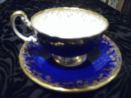 Aynsley cobalt blue and gold teacup and saucer England
