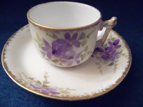 Antiques Violets demitasse cup and saucer set