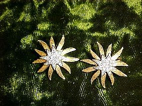 Sunstar goldtone and silver earrings