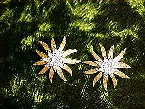 Sunstar goldtone and silver earrings