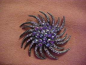 Twisting starburst purple aurora rhinestone pin
