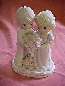 """Love vows to always bloom"" Precious moments figurine cake topper"