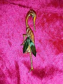 Stork pin with emerald green stones