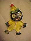 Bakelite googley eyed black clown pin