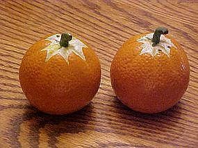 Oranges, salt and pepper shakers