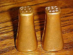 Small gold salt and pepper shakers