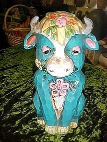 Retro 1960's flower power, turquoise bull bank