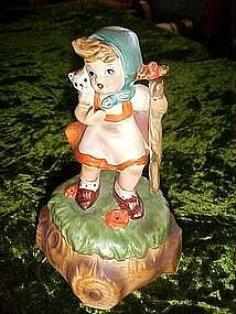 "Hummel type  musical figurine, plays ""Tomorrow"""