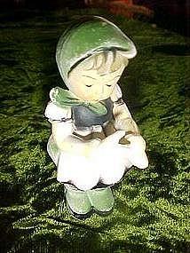 Plastic hummel look alike figurine with scissors