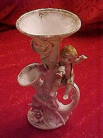 Old porcelain horn vase with cherub and roses