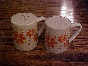 Retro 70's porcelain orange & yellow daisy shakers