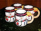 Four ceramic snowman mugs, by Carson ceramics