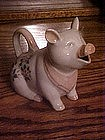 Floral decorated pig creamer