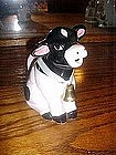 Sitting black and white cow cream pitcher w/bell