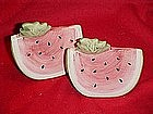 Large watermelon slices, salt and pepper shakers