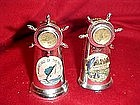 Older Marineland souvenir shakers with compass