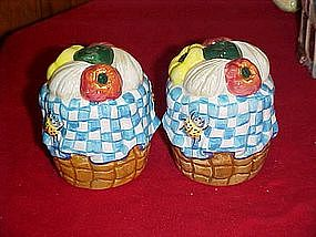 Basket of garden vegetables, salt and pepper shakers