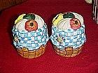 Basket of garden vegetables, salt and pepper shakers