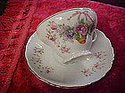 Vintage tea cup and saucer with flower basket pattern