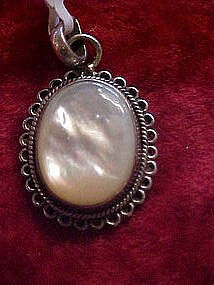 Pretty mother of pearl and sterling silver pendant