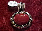 Sterling silver and coral pendant