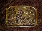 Cowboy and wagon train, brass belt buckle