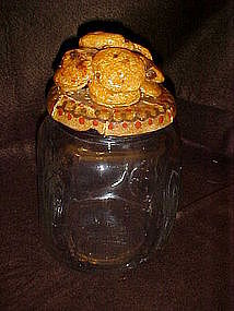 Clear glass cookie jar with real cookies on top