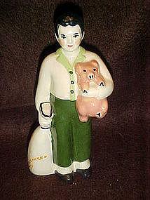 Ceramics arts studios, boy and pig figurine