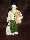 Ceramics arts studios, boy and pig figurine
