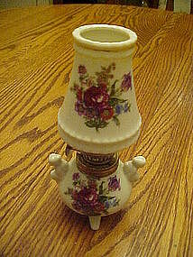Miniature ceramic lamp with florals, and three legs