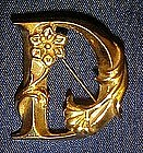 Avon art Noveau style initial pin, D