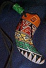 Claw shaped Peruvian clay whistle, hand painted