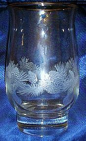 Crystal tumbler with pine cones and needles