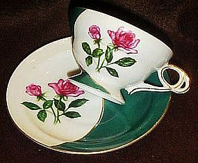 Fancy china teacup and saucer set,   green with roses