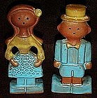 Vintage clay man and woman salt and pepper shakers.